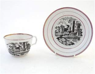 A tea cup and saucer with monochrome transfer