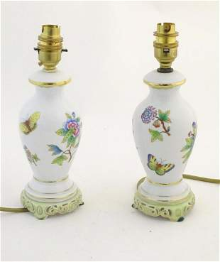 A pair of Herend pottery table lamps decorated with