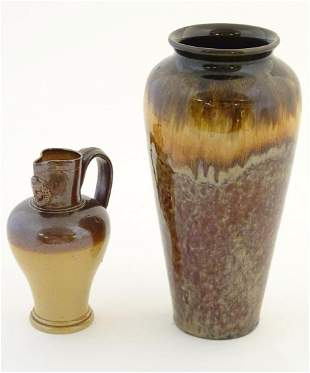 A Doulton Lambeth two tone stoneware jug with relief