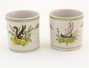 Two Continental faience coffee cups, one decorated with