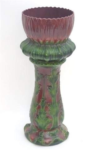 A large Victorian majolica jardiniere on stand of
