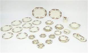 A quantity of Crown Ducal dinner wares in the pattern