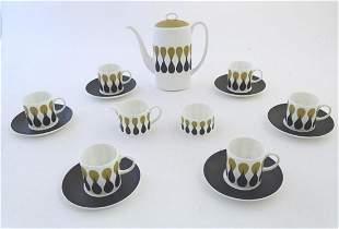 A quantity of retro Susie Cooper coffee wares in the