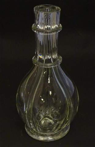 A mid 20thC four-sectional decanter, the base marked