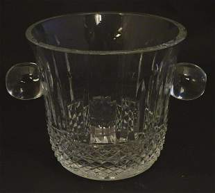 An early 20thC lead crystal ice bucket, decorated with