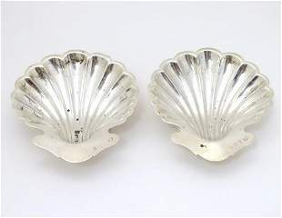 A pair of butter dishes / shells of scallop shell form.