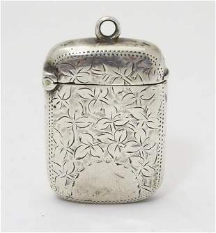 A Victorian silver vesta case with engraved decoration.