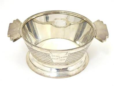 An Art Deco silver porringer with engine turned