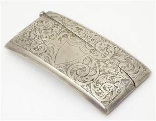 A silver visiting card case of shaped form with