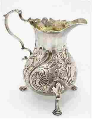 "A Geo III silver cream jug London 1762 maker WC. 4"""