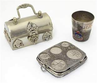 Three silver plate items comprising a coin holder,