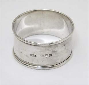 A silver napkin ring, hallmarked Chester 1916, maker