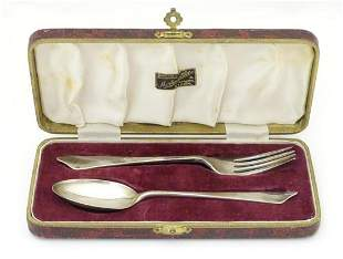 A silver christening set comprising spoon and fork,