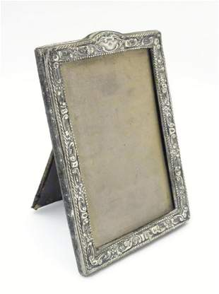 An easel back photograph frame with silver surround,