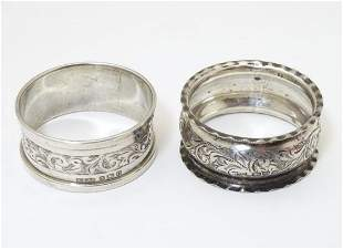 Two silver napkin rings, one hallmarked Birmingham