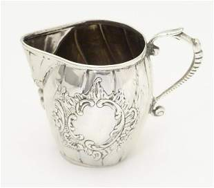 A Continental silver cream jug with import marks for