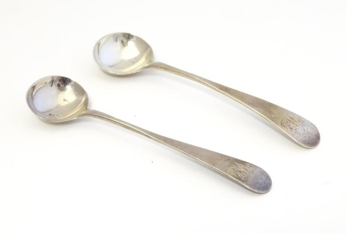 A pair of Geo III silver salt spoons. Hallmarked London