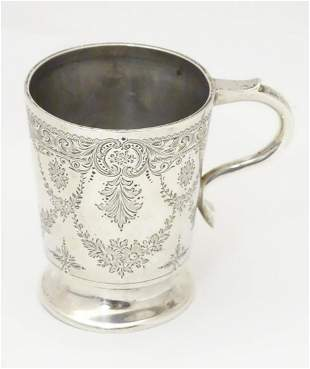 A Victorian silver christening mug with engraved
