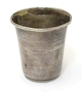 A silver vodka / tot cup with engraved decoration,
