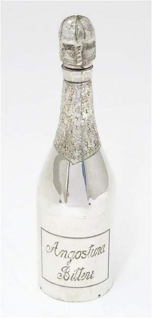 A silver plate flask formed as a bottle titled
