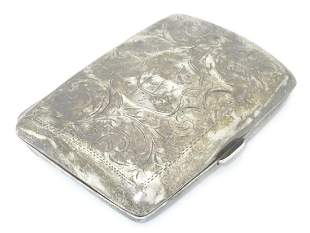 A silver cigarette case, hallmarked Birmingham 1916,