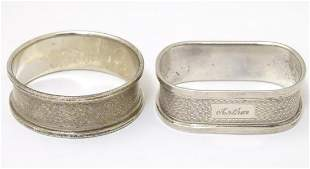 Two silver napkin rings with engine turned decoration,
