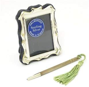 A photograph frame with silver surround, hallmarked