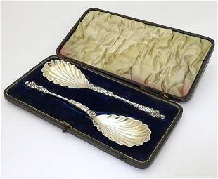 A cased set of Victorian silver plate serving spoons,