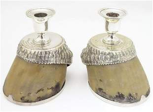 A pair of Victorian horse hoof formed candlesticks with