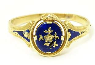 A 19thC yellow metal bracelet of bangle form with blue