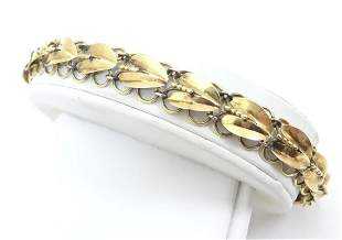 An 18ct gold bracelet decorated with stylised honesty