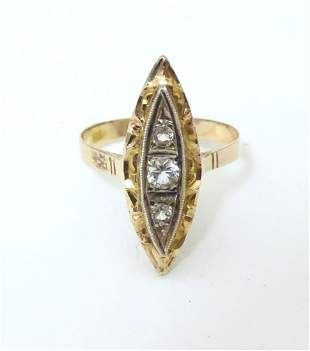 A 14ct marquise ring set with central white stone