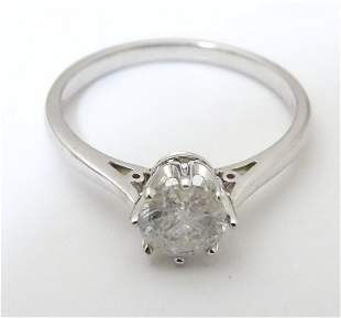 An 18ct white gold diamond solitaire ring. The diamond