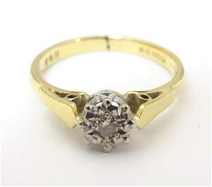 An 18ct gold ring set with diamond solitaire . Ring