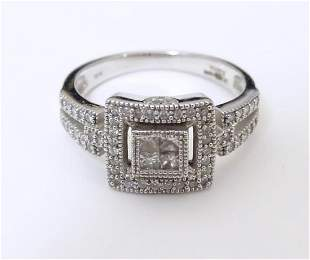 An 18ct white gold ring set with a profusion of