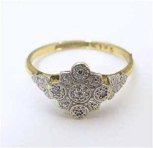 An 18ct gold ring set with central diamond bordered by