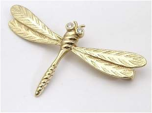 A vintage gilt metal brooch / pin formed as a dragon