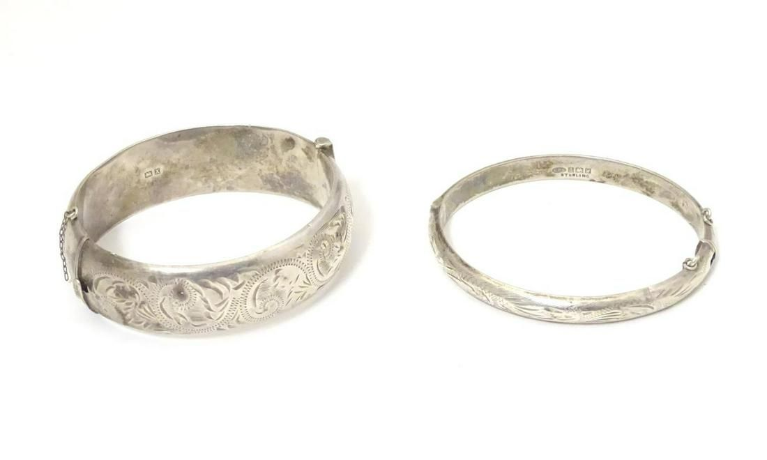 Two silver bracelets of bangle form, one hallmarked