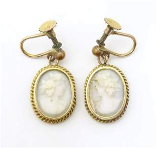 A pair of gilt metal drop earrings set with white