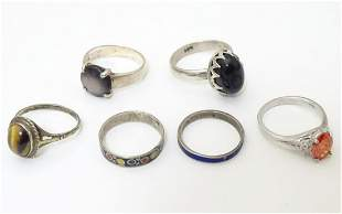 Six various silver and white metal rings, set with