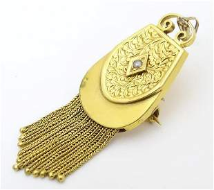 An 18ct gold pendant / brooch formed as a Scottish