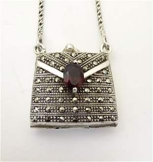 A silver pendant / vinaigrette formed as a purse /