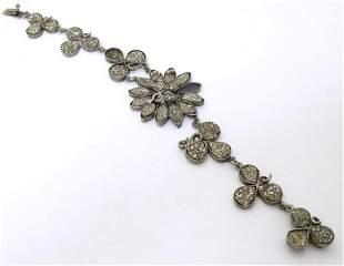 A vintage silver plate bracelet set with pyrite stones.