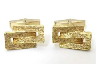 A pair of retro 18ct gold cufflinks of abstract form,