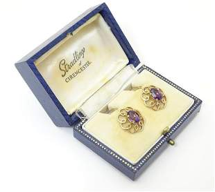 """A pair of 9ct gold amethyst earrings. Approx. 3/4"""" long"""