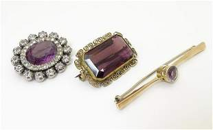 A 15ct gold bar brooch set with central amethyst.