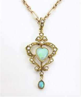 An Art Nouveau 15ct gold pendant set with opals and