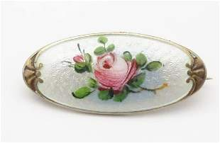 A silver brooch with guilloche enamel and hand painted
