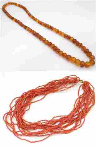 A graduated bead necklace of facet cut amber coloured