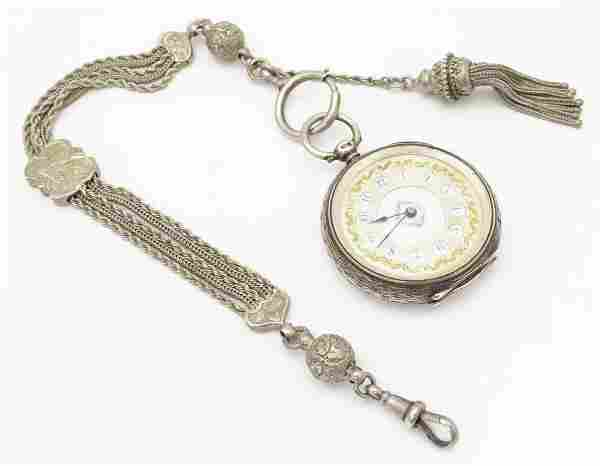 A Victorian silver pocket watch with enamel dial with